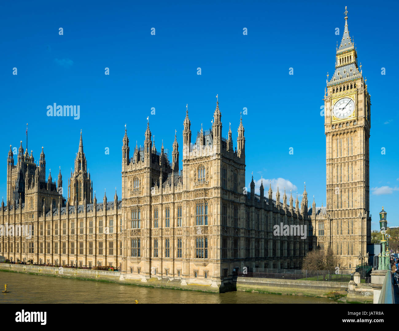 Bright blue sky morning view of Big Ben and the Houses of Parliament at Westminster Palace from the nearby bridge Stock Photo