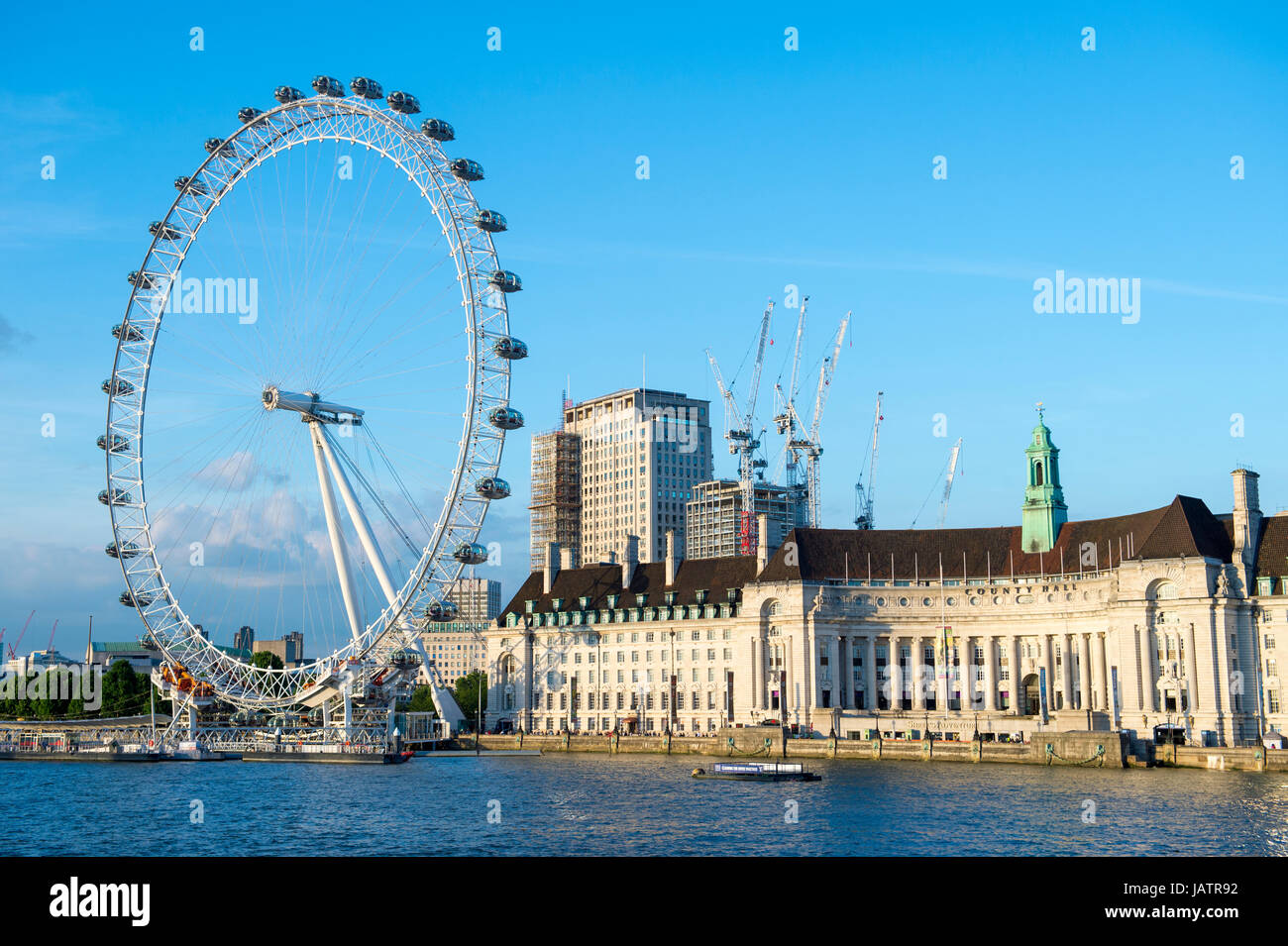View from Westminster Bridge across river thames to the London Eye and for Greater London Council building - Stock Image