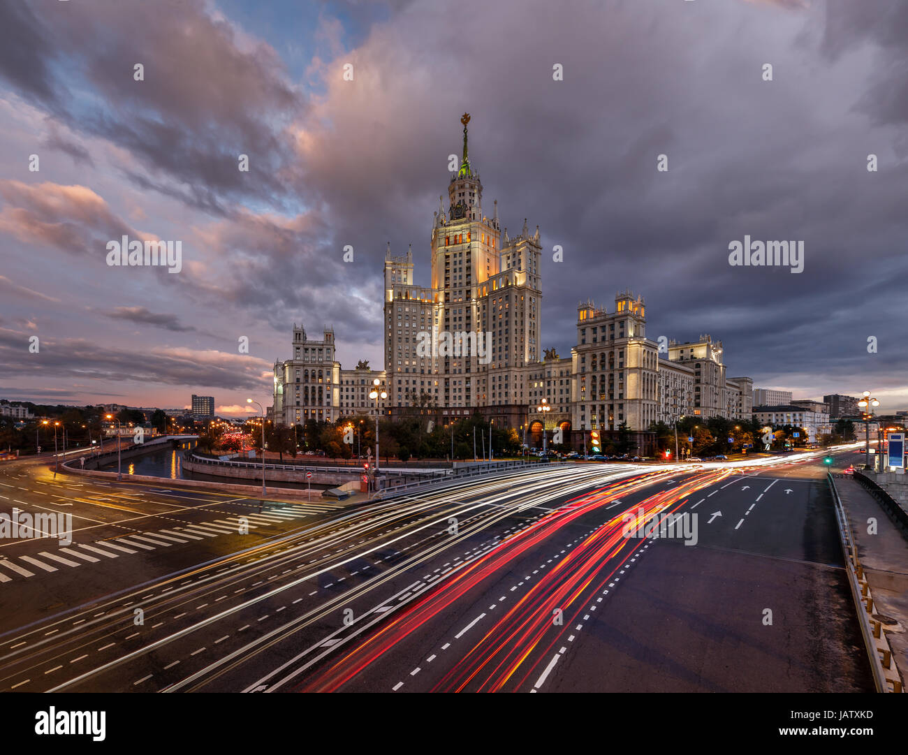Skyscraper on Kotelnicheskaya Embankment and Traffic Trails at Dusk, Moscow, Russia Stock Photo