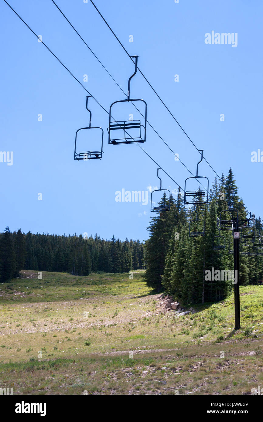 Empty ski lift seats in alpine summer landscape Stock Photo ...