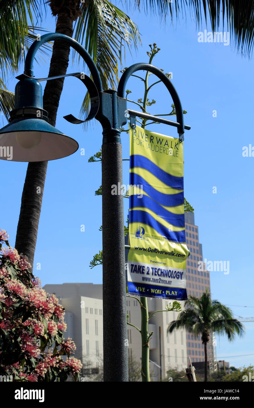 FORT LAUDERDALE, FLORIDA - FEBRUARY 3: Yellow and blue hanging banner showing the goriverwalk.com website and current - Stock Image