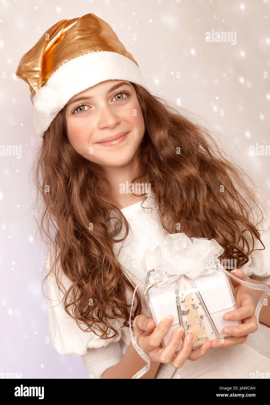 exceptional Cute Little Teen Part - 18: Closeup portrait of cute little Santa helper, sweet teen girl with white  wrapping gift box on pink snowing background