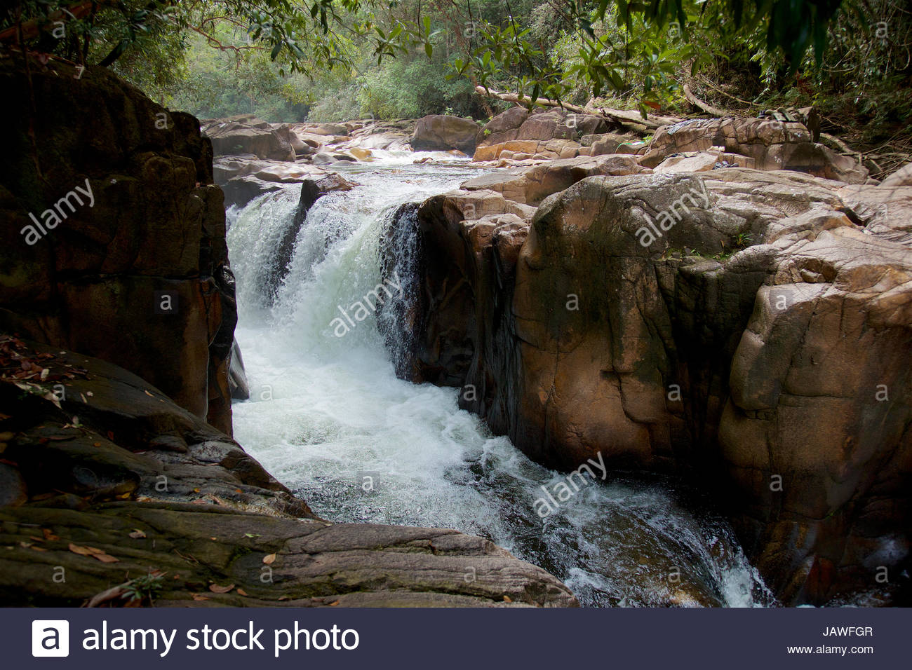 Riam Parit, or the Channel Falls, an unusual slot waterfall on the upper Siduk River. - Stock Image