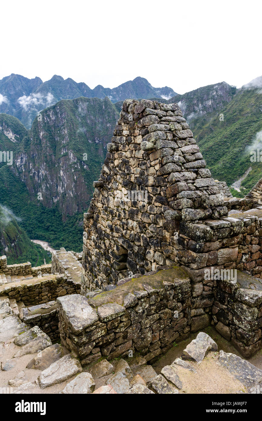 A trapezoidal wall in a residential building at Macchu Picchu. - Stock Image