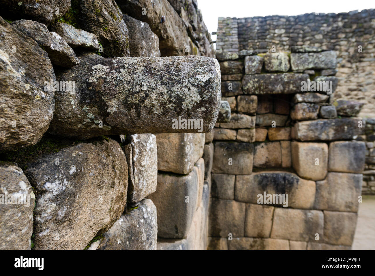 A stone joist emerges from a wall to support a ceiling in a Inca building. - Stock Image