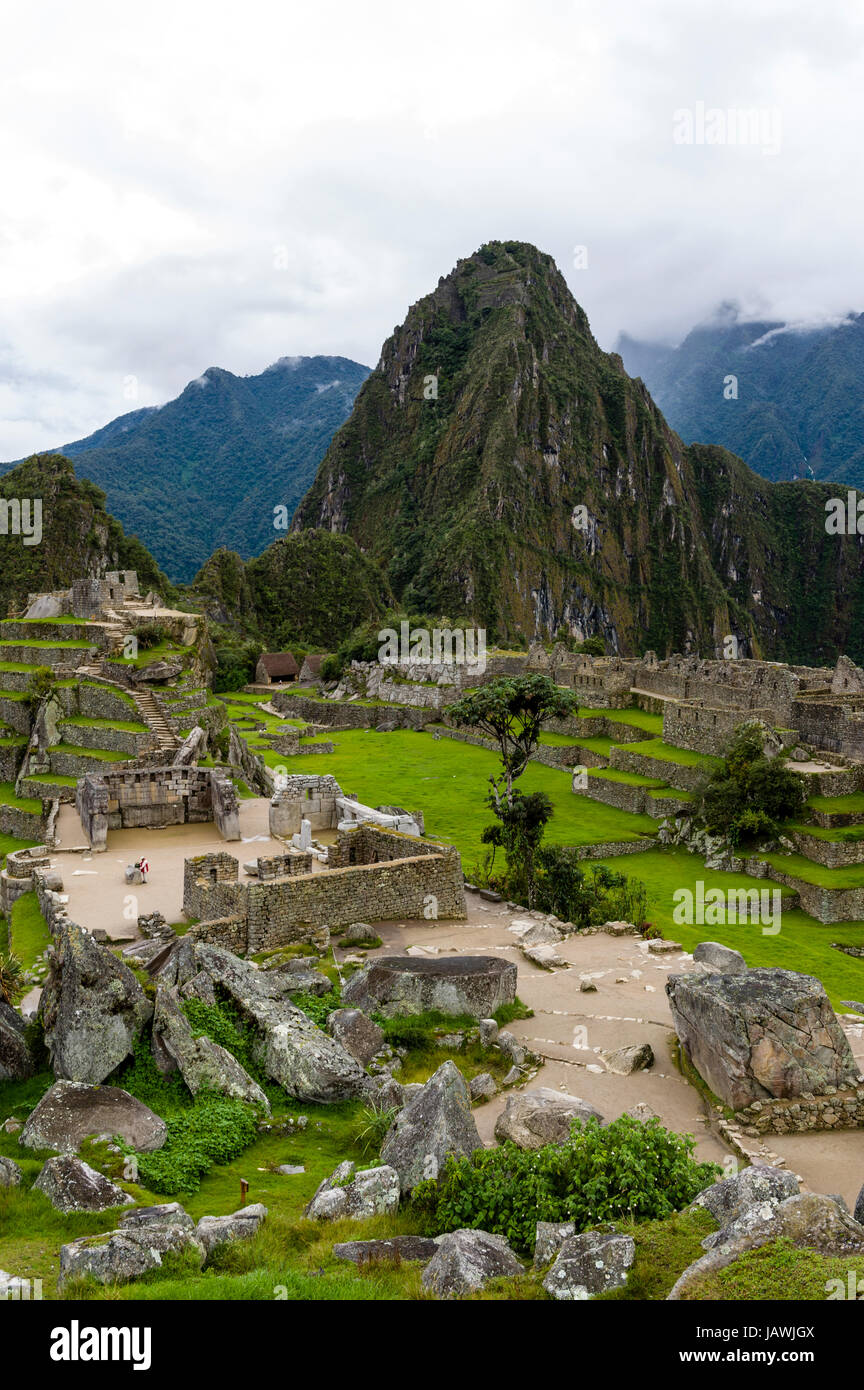 The ancient Inca ruins at the base of Huayna Picchu in the Andes. - Stock Image