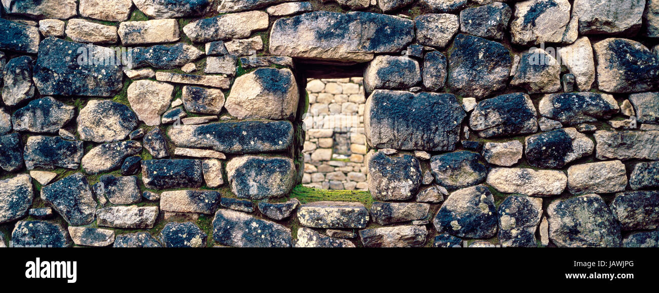 A window in a trapezoidal wall in a residential building at Macchu Picchu. - Stock Image