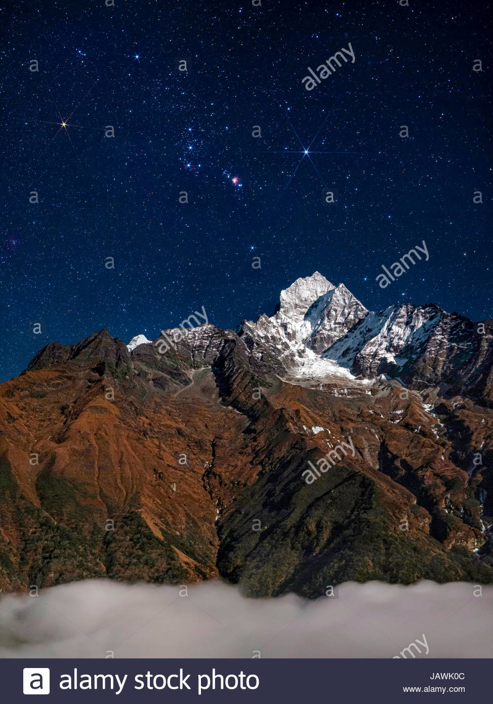 Constellation of Orion, rises above Himalayas in the Sagarmatha National Park of Nepal. - Stock Image