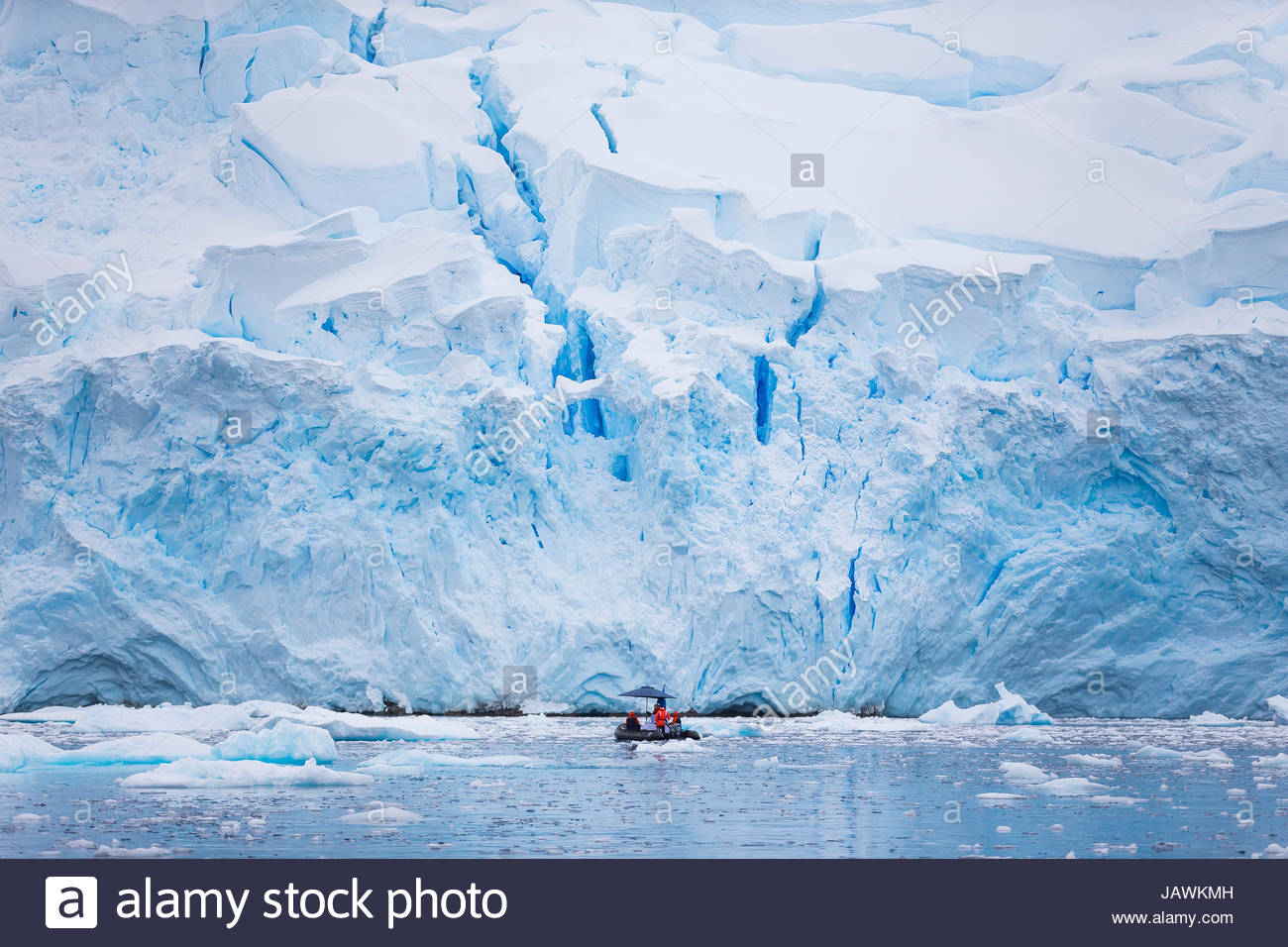 Exploring glaciers in Cierva Cove in Antarctica with small inflatable boats. - Stock Image