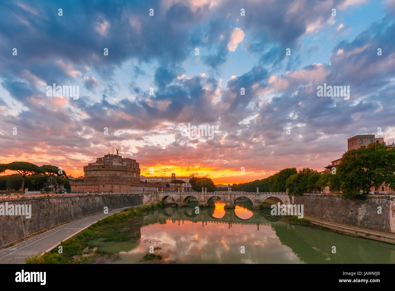 Saint Angel castle and bridge at sunrise, Rome - Stock Image