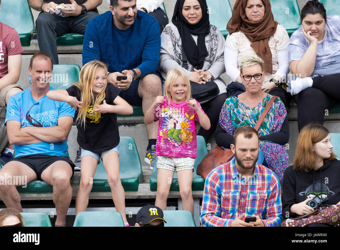 spectators cheering and laughing - Stock Image