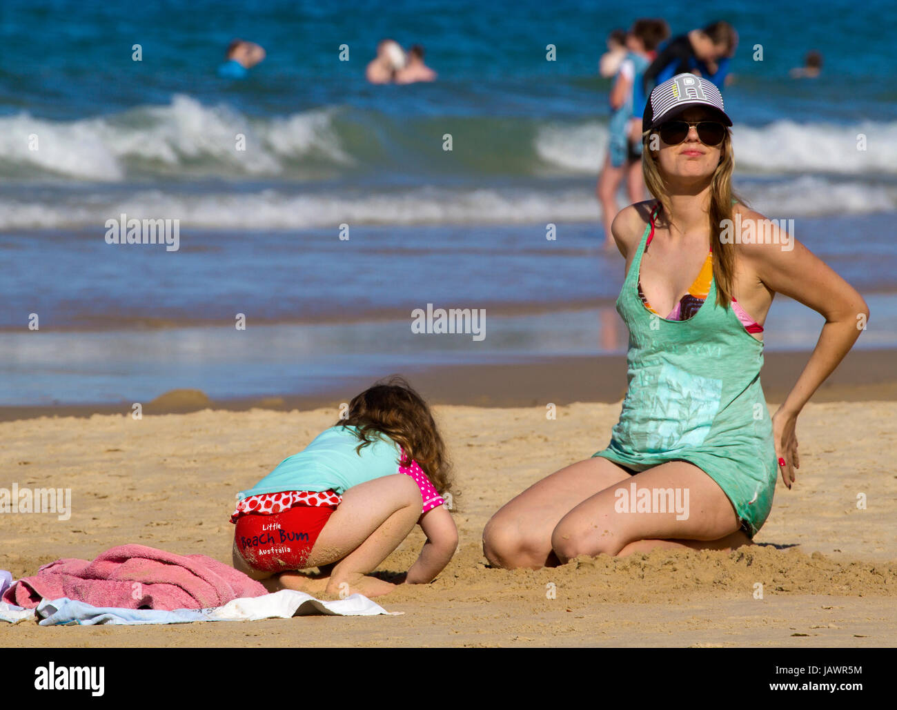 Candid photography shot in street, beach, parks and aother locations - Stock Image