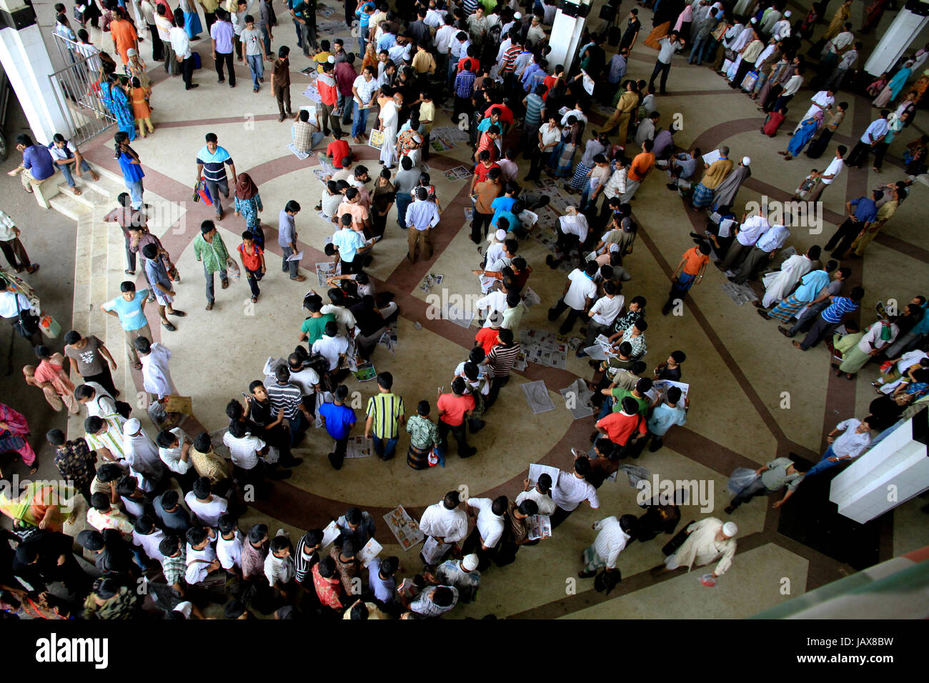 Dhaka city residents queue up at Kamlapur Railway Station in a bid to secure a ticket to head home for the Eid-ul - Stock Image