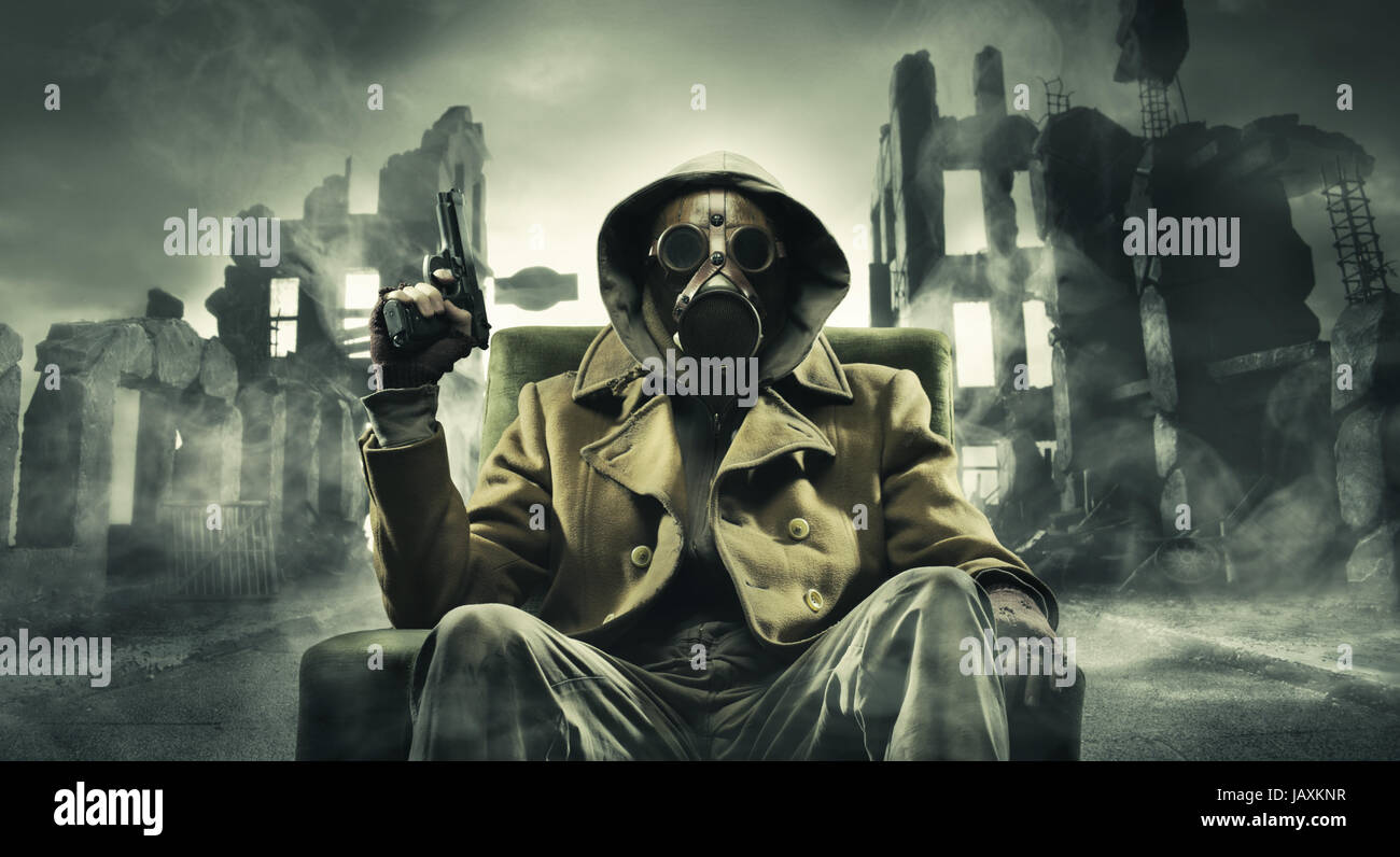 Post apocalyptic survivor in gas mask, destroyed city in the background - Stock Image