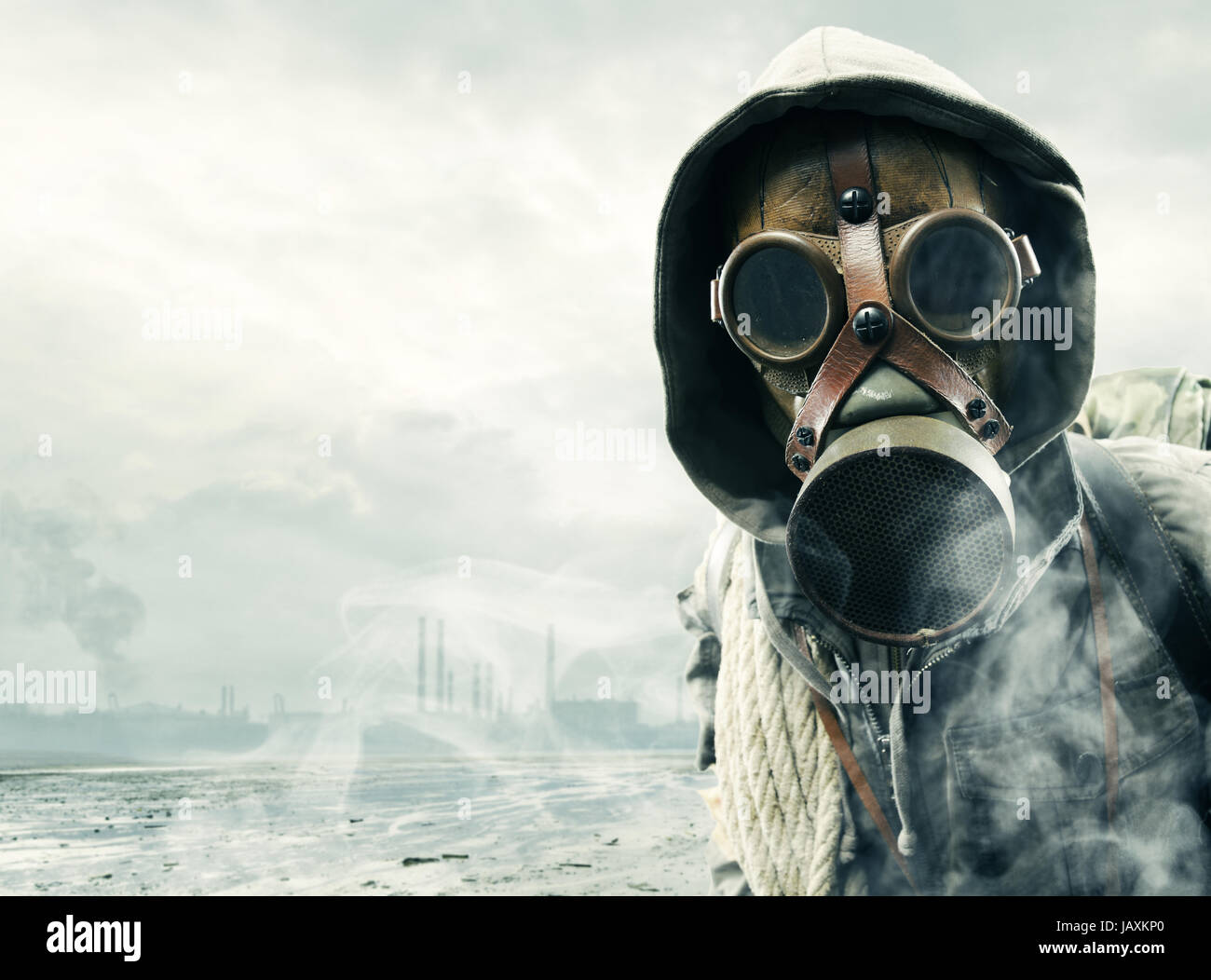 Environmental disaster. Post apocalyptic survivor in gas mask - Stock Image