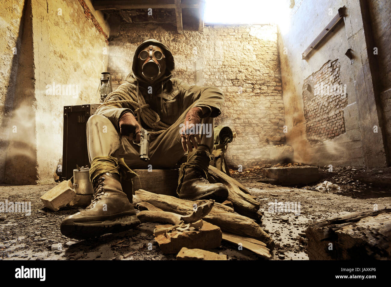 Post apocalyptic survivor in gas mask - Stock Image