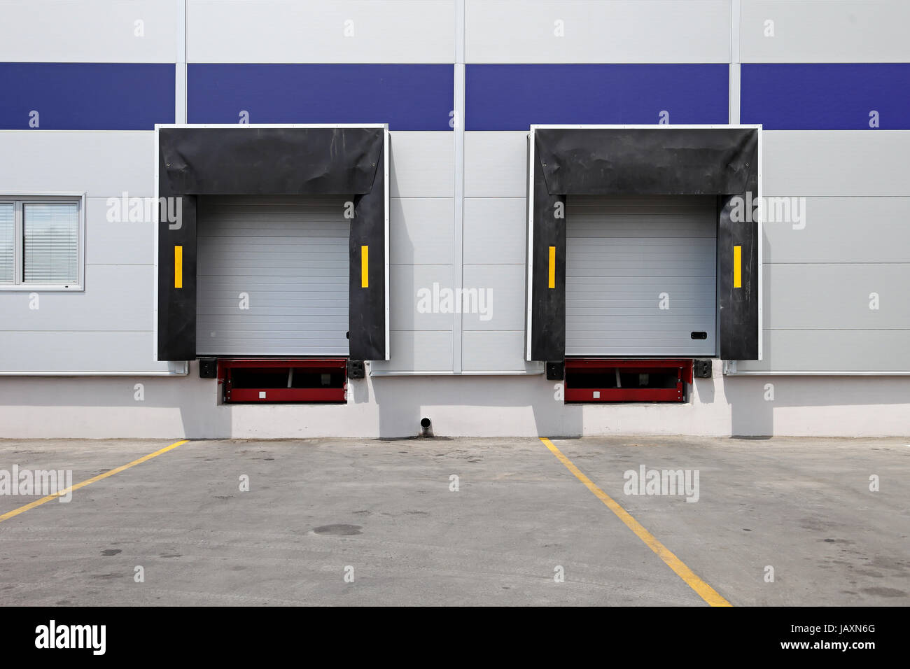 Two dock doors at warehouse for loading lorry & Two dock doors at warehouse for loading lorry Stock Photo: 144416904 ...