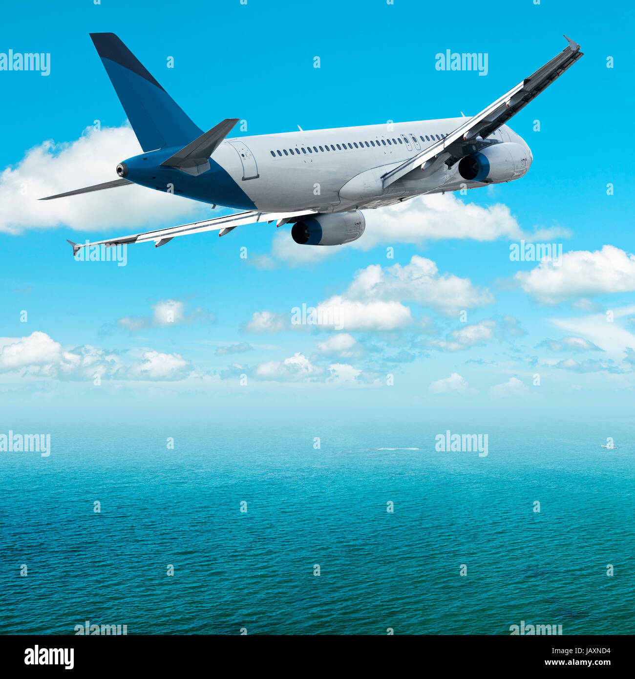 Jet over the tropical sea Stock Photo