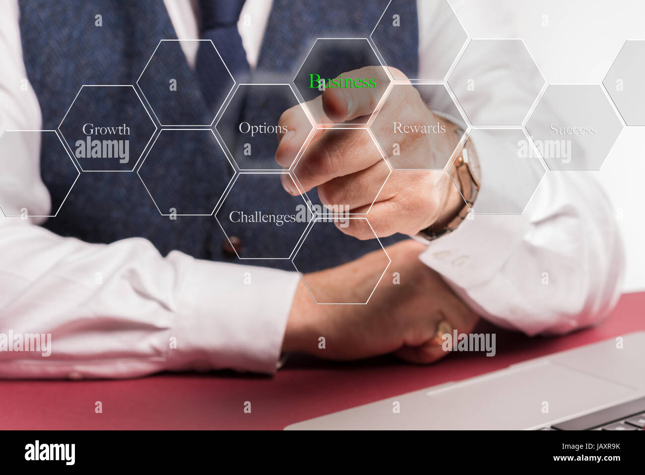 Concept image of Businessman sitting at desk pushing virtual button on screen saying Business growth options challenges - Stock Image