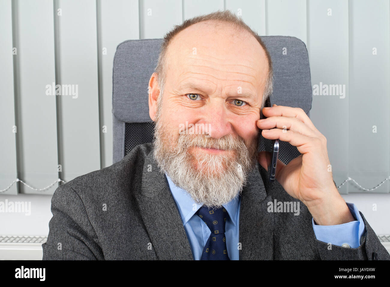 Portrait of a smiling businessman talking on the phone Stock Photo