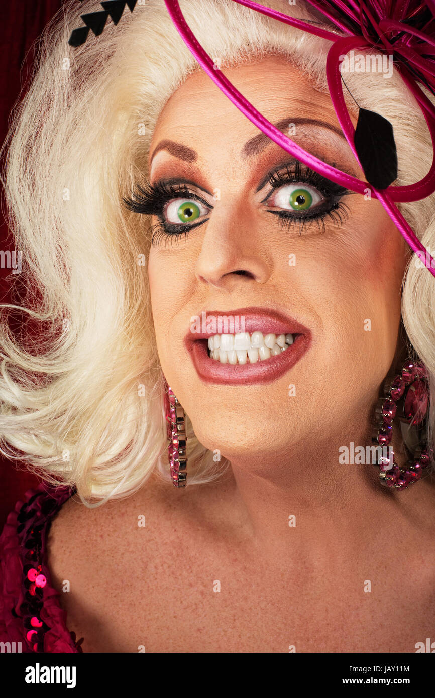 Smiling Blond Drag Queen With Big Eyelashes Stock Photo