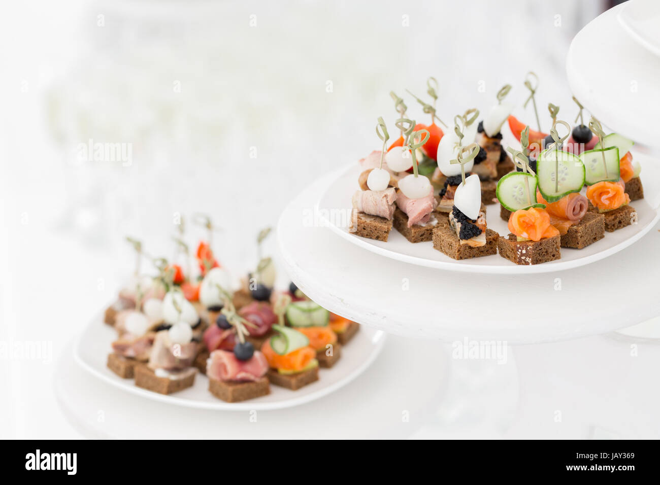 the buffet at the reception. Assortment of canapes. Banquet service. catering food - Stock Image