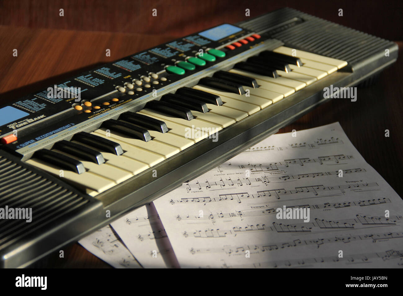 Close view of Synthesizer with musical notes - Stock Image
