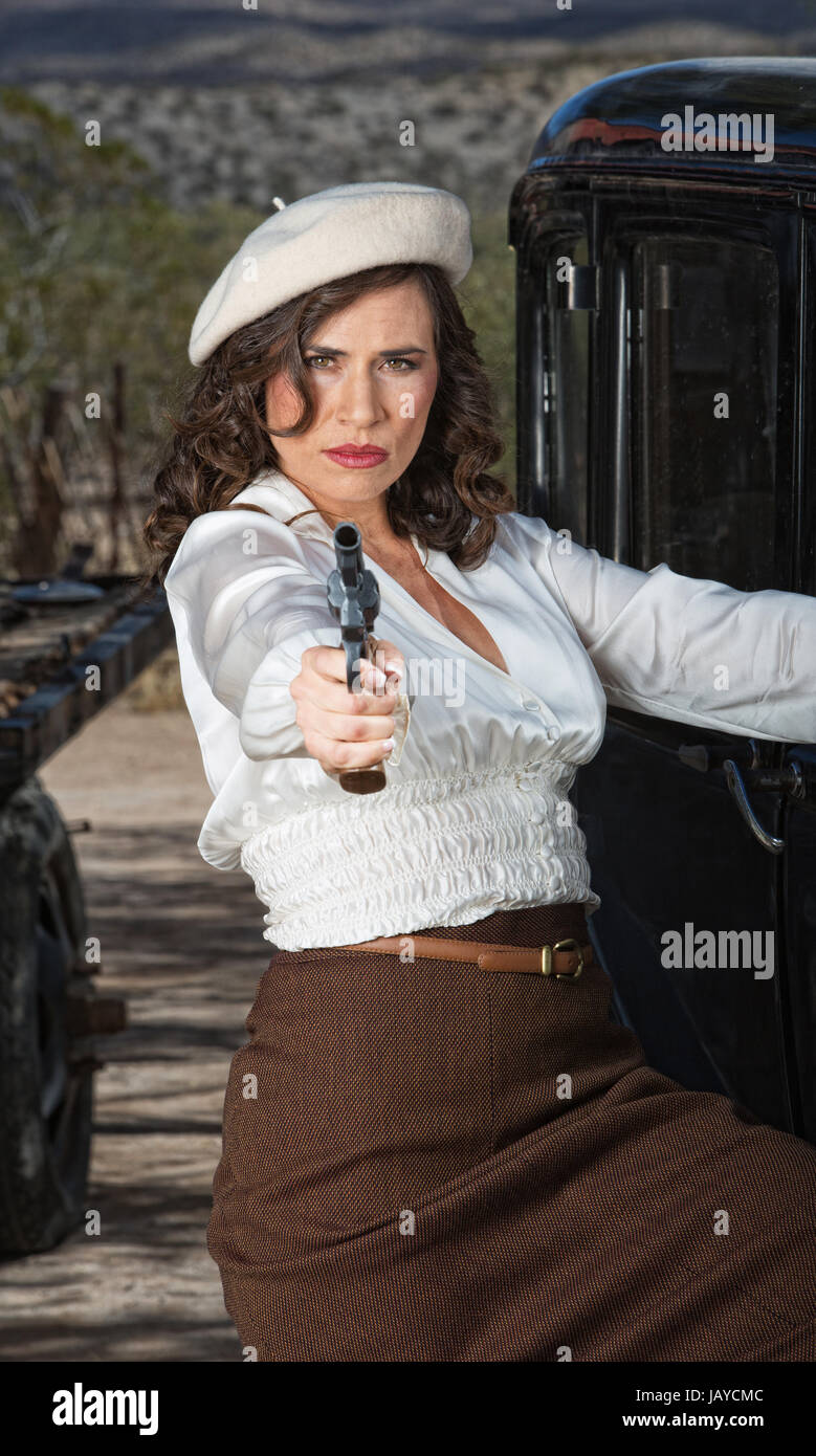 1920s vintage gangster woman aiming pistol stock photo