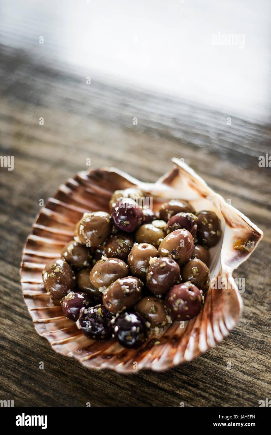 gourmet garlic and herb marinated fresh olives tapas snack starter - Stock Image