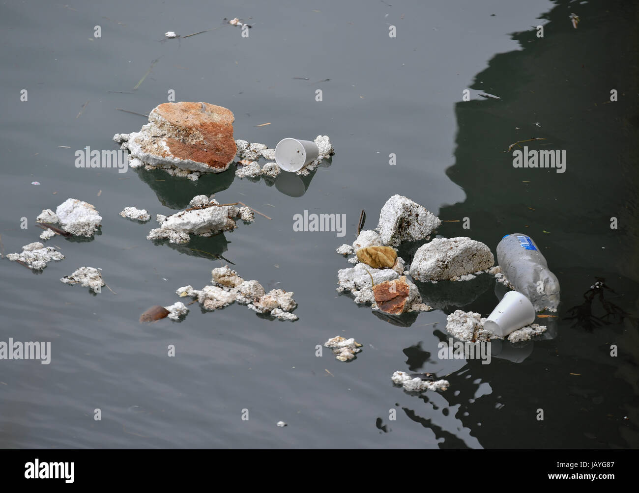 Plastic and polystyrene pollution floating in Southampton water  where cruise ships and container ships come to - Stock Image