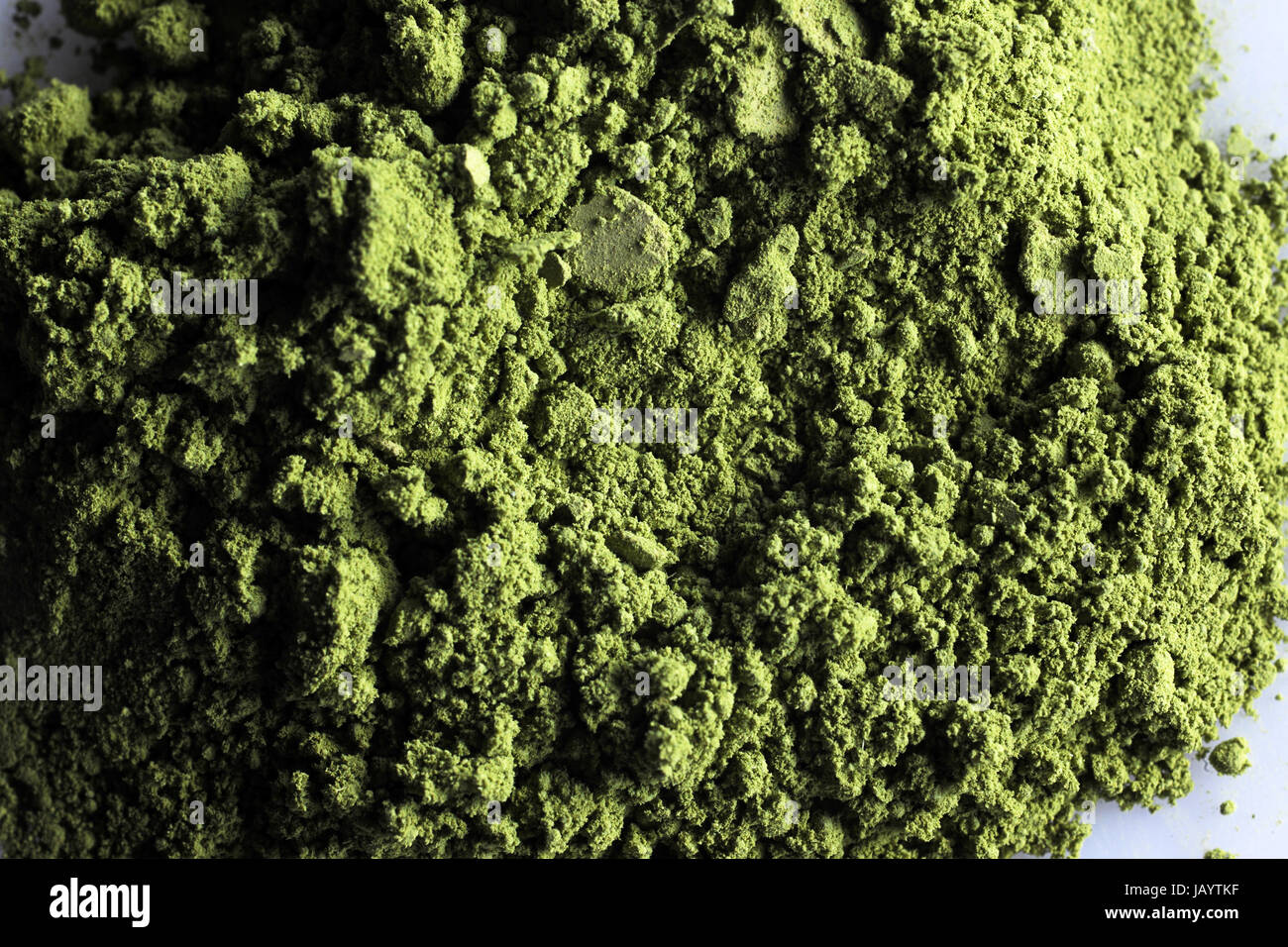 matcha powder green tea with white background - Stock Image