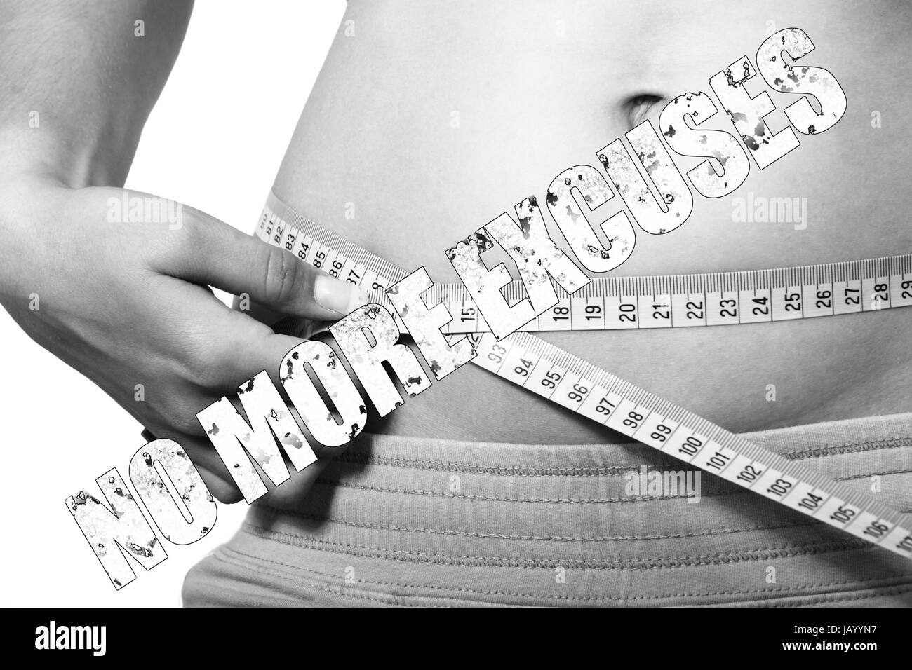 Measurement tape around belly with text No More Excuses - Stock Image