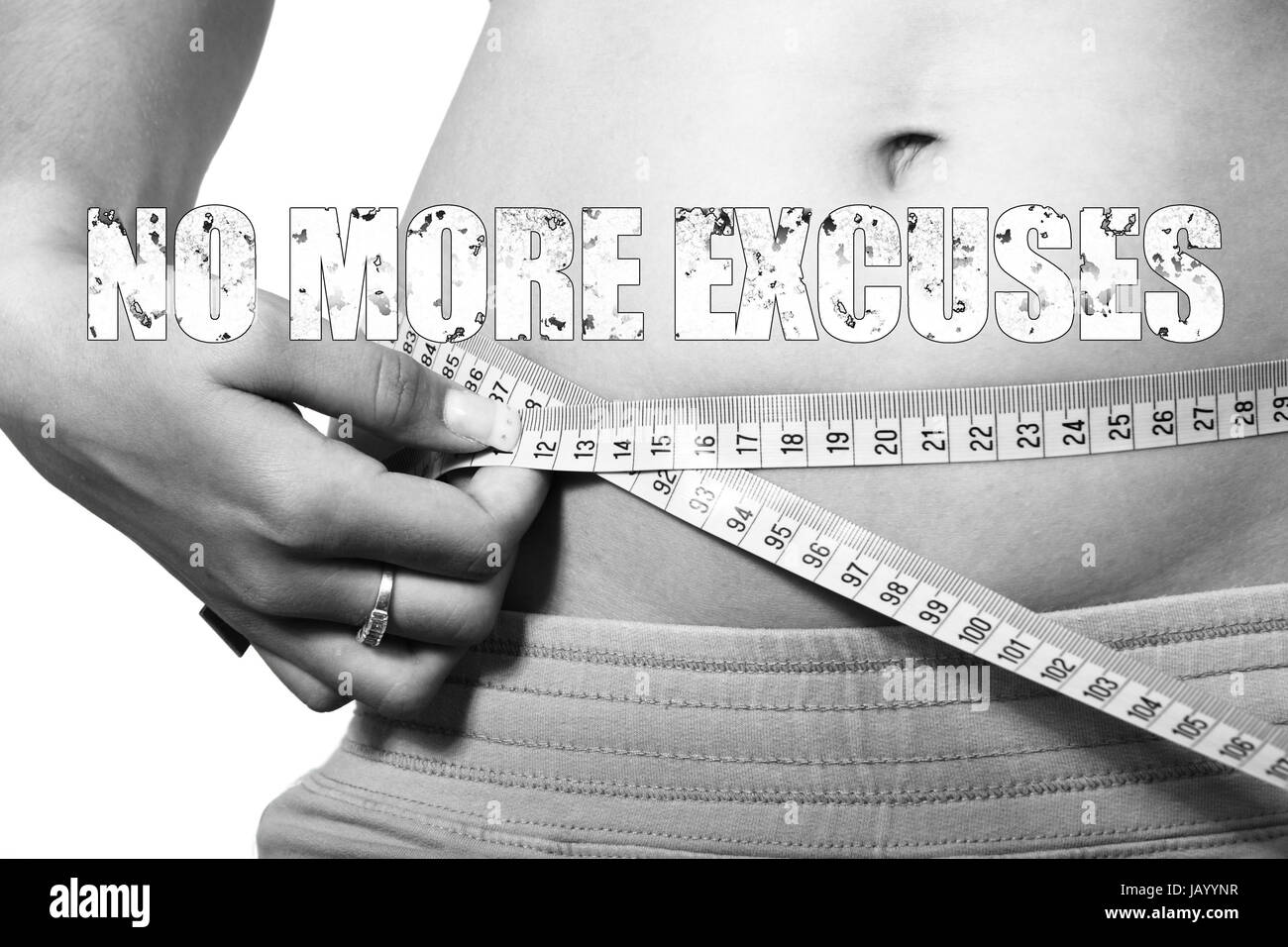 Measurement tape around belly showing belly size with text No More Excuses - Stock Image