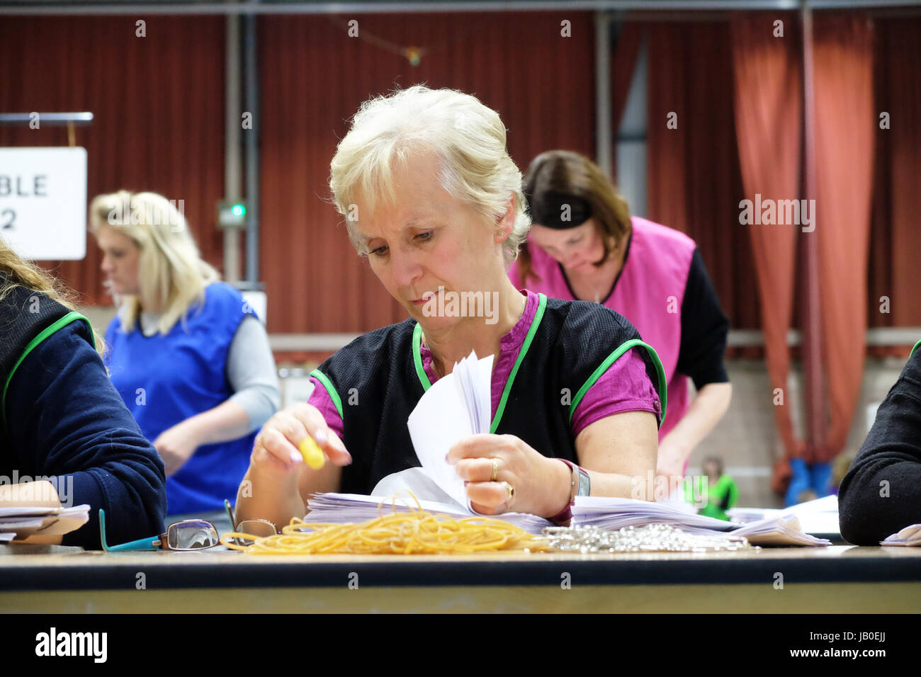 Hereford, Herefordshire, UK - Thursday 8th June 2017 - Counting staff begin the process of counting the votes per - Stock Image