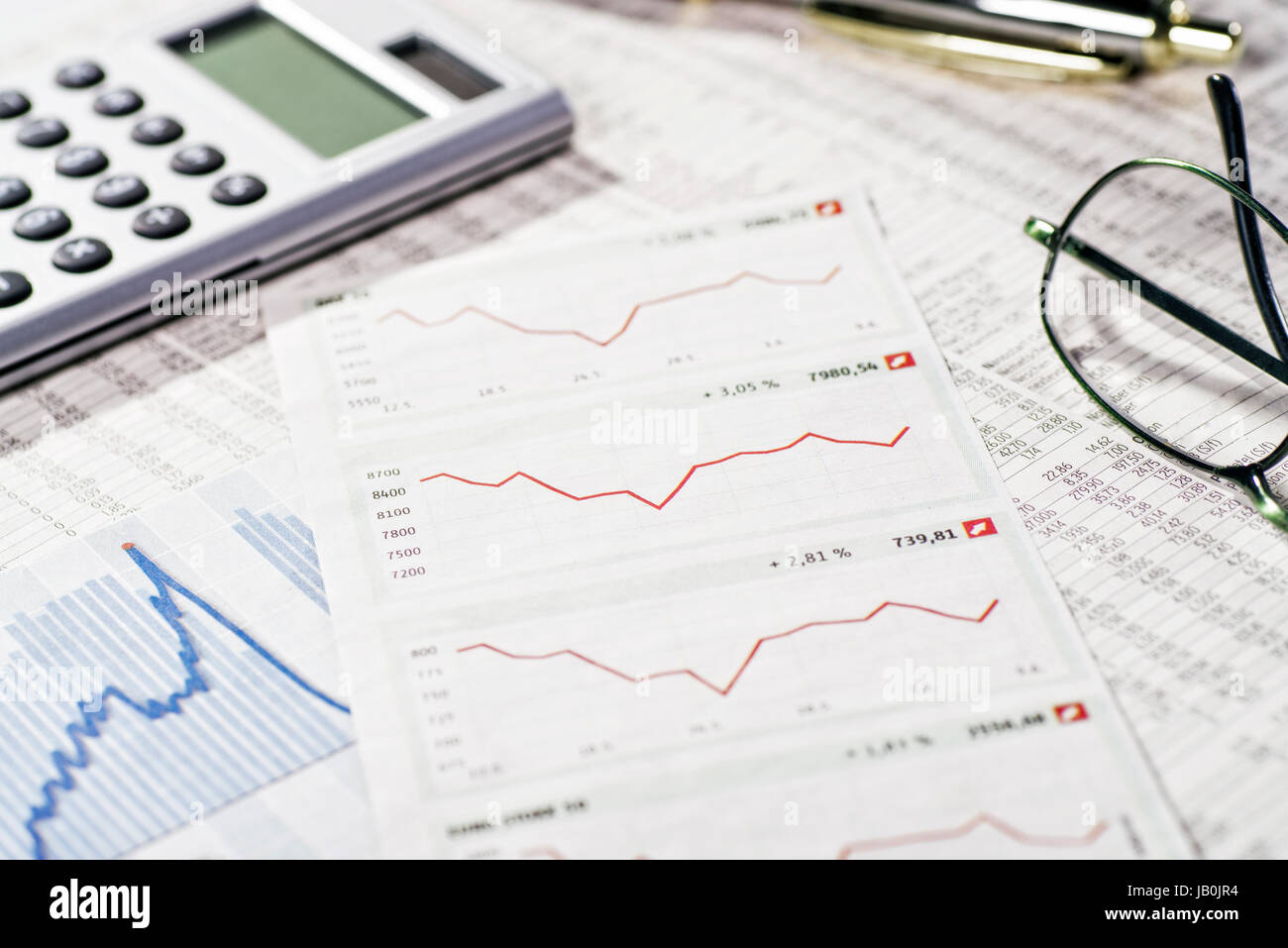 Charts, rate tables and calculator as a symbol of the development of the financial market. - Stock Image