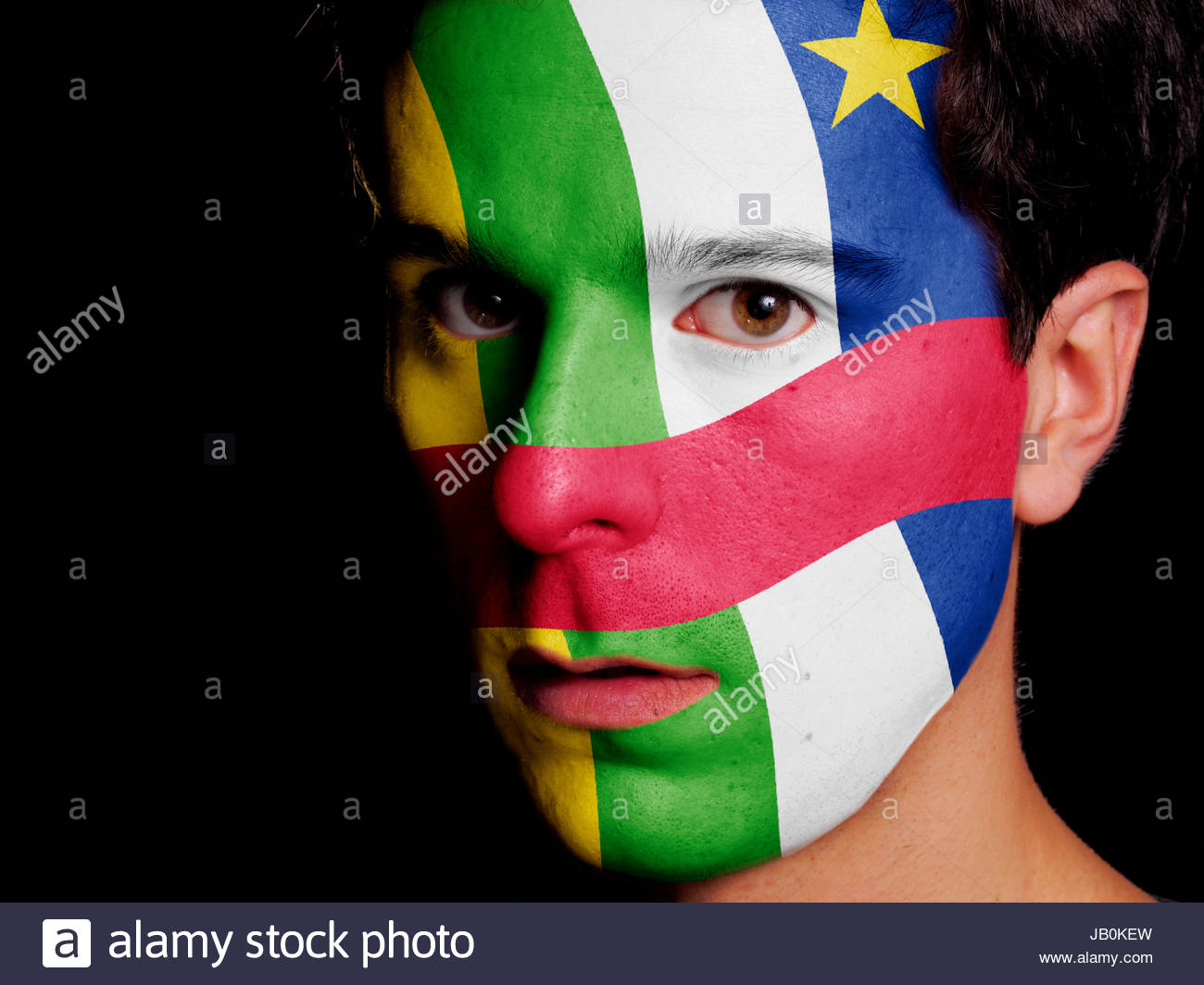 Flag of Central African Republic Painted on a Face of a Young Man - Stock Image