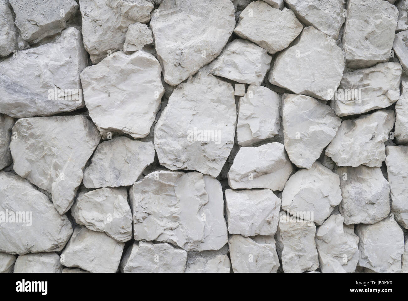 Close up background of white stone wall architecture wallpaper - Stock Image