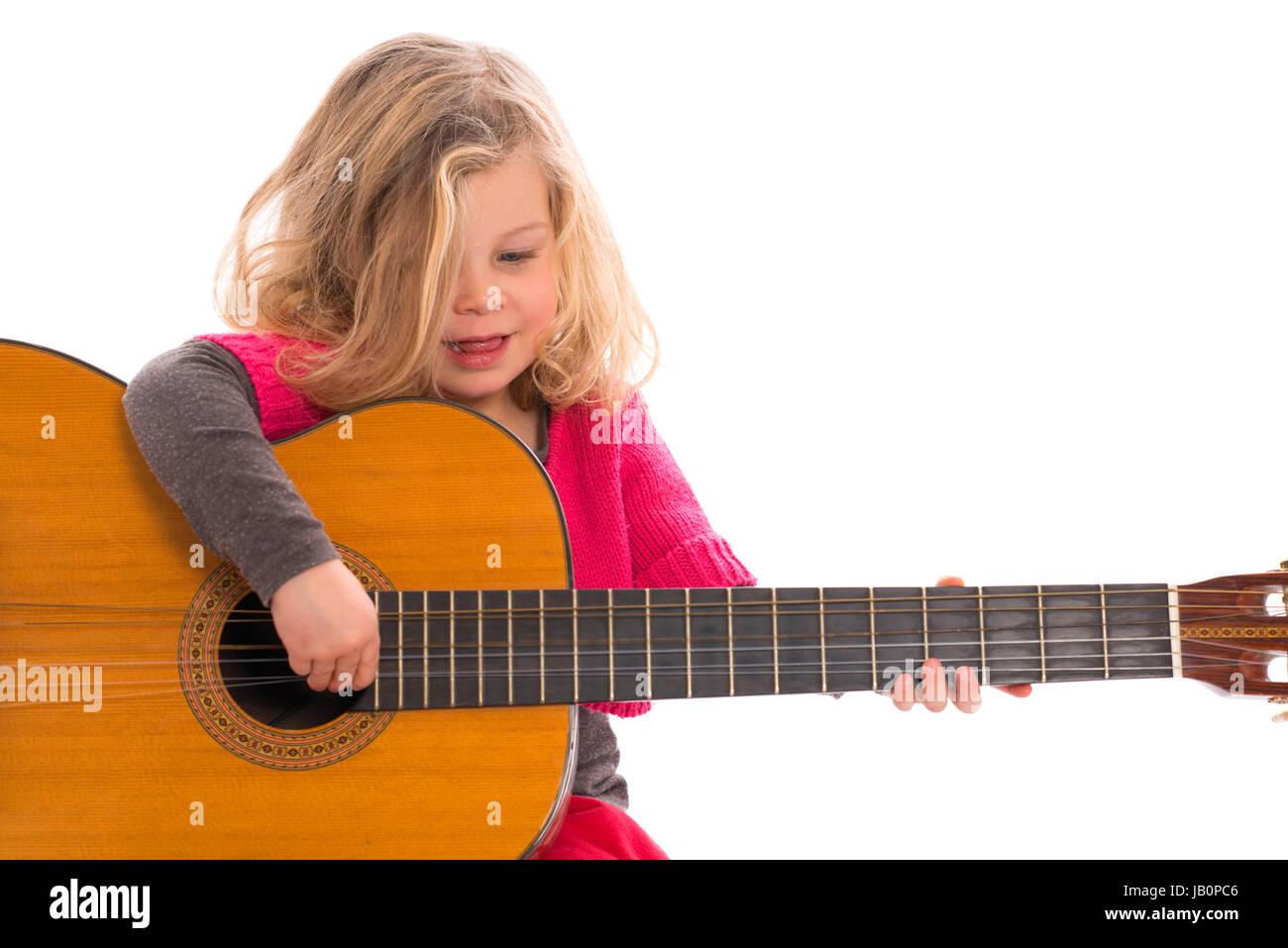 little girl plays guitar stock photo 144461750 alamy