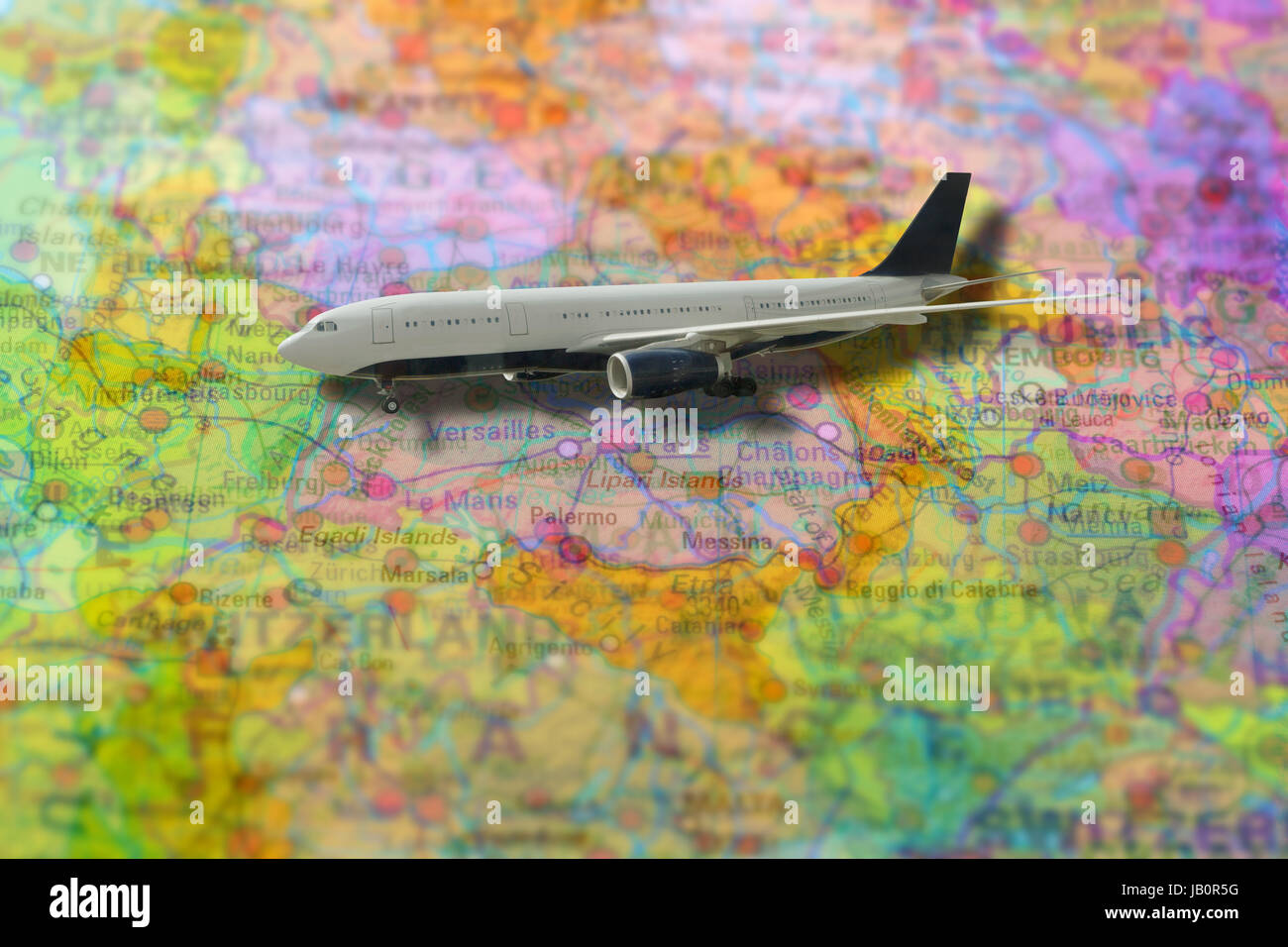 Pinned flight of plane travelling on colorful political map of Stock ...