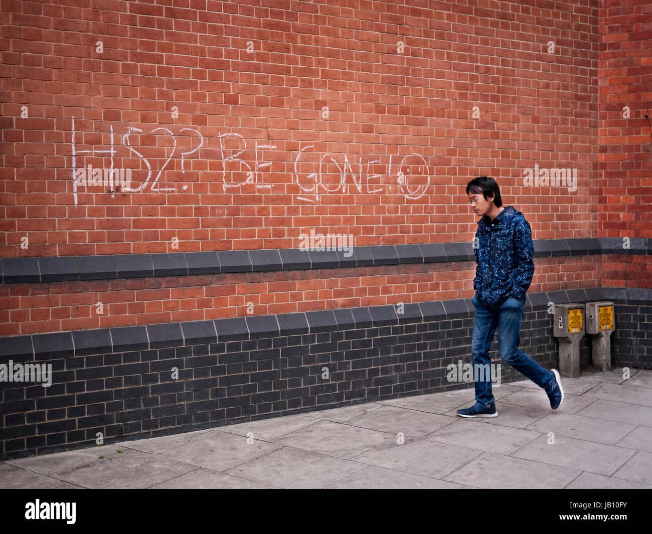 Anti HS2 Graffiti on a wall close to Euston station in Camden London UK Stock Photo