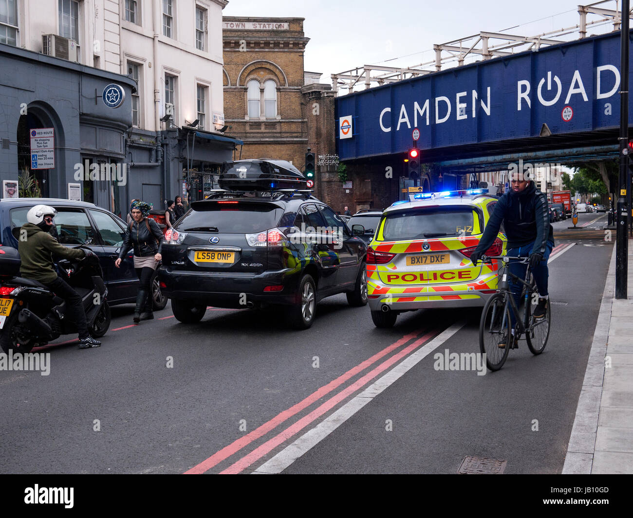 Police car has to drive on a separated cycle lane on an emergency call Royal College Street Camden Town London UK - Stock Image