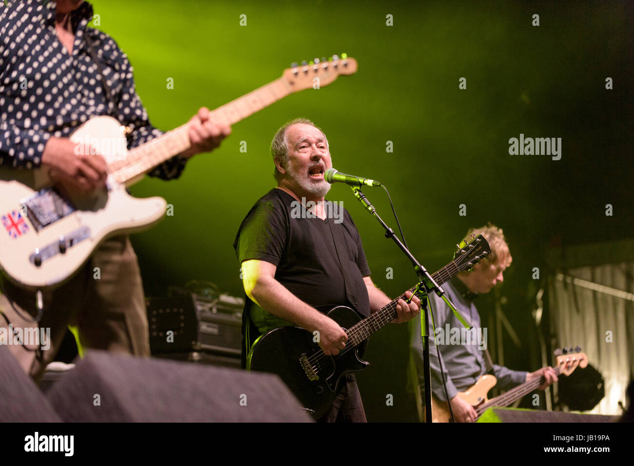 The Buzzcocks (Pete Shelley) perform at Wychwood Festival, Cheltenham, UK - Stock Image