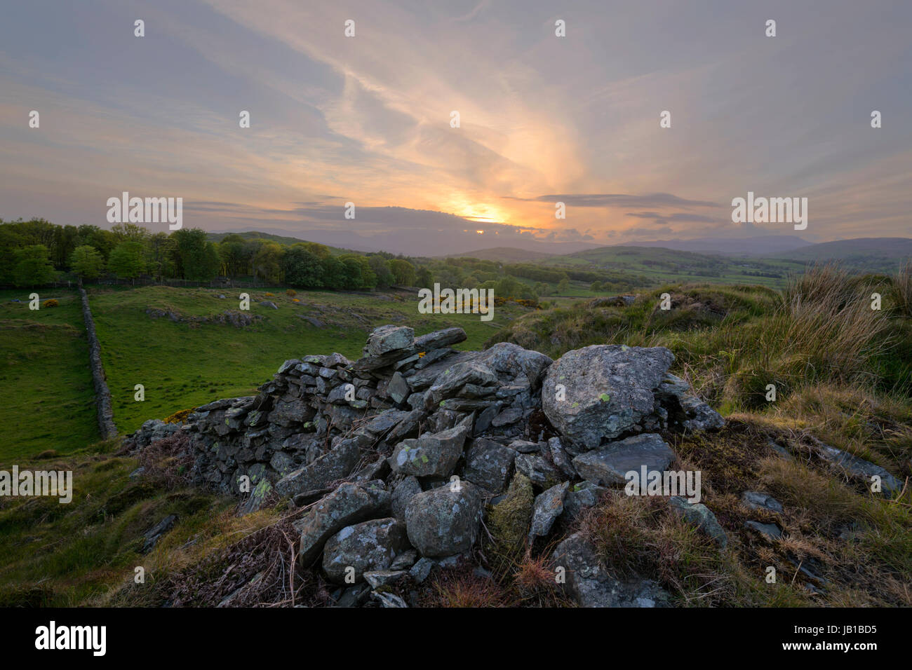Setting sun in a rural setting near Crook Kendal in Cumbria - Stock Image