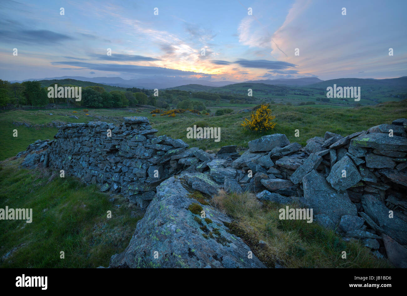 Sundown over a rural setting at Crook in the Lake District - Stock Image