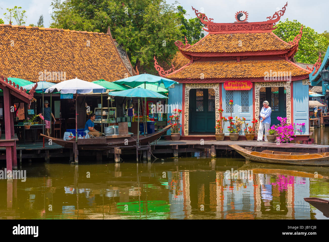 Laem Chabang, Thailand -- March 16, 2016 -- Tourists shopping in a water market in Thailand. Editorial Use Only. Stock Photo