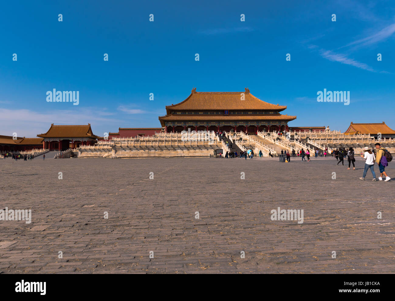 Tourists go to visit the Hall of Supreme Harmony at the center of the Forbidden City. - Stock Image