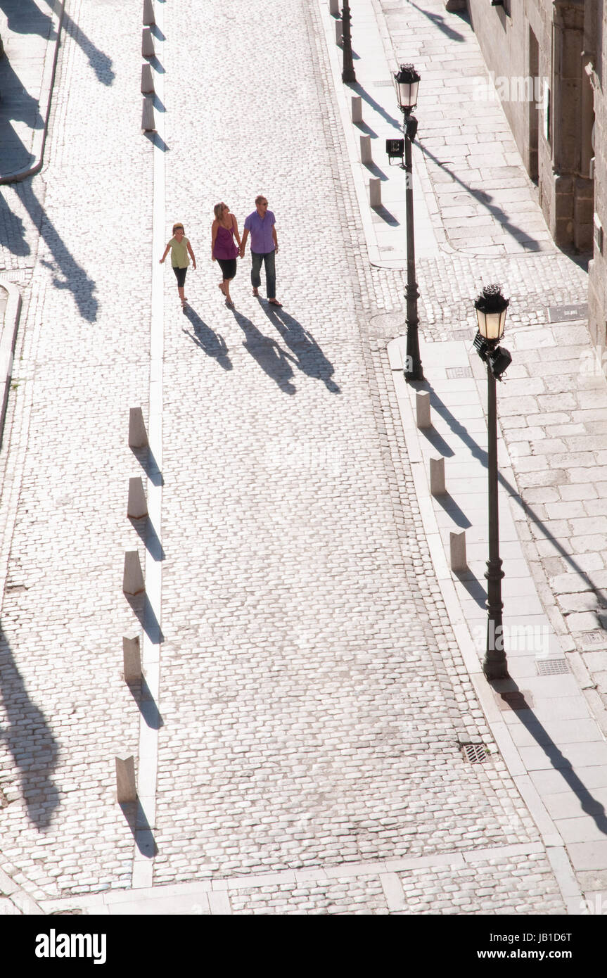 Family walking along the Cathedral Square, aerial view. Avila, Castilla Leon, Spain. Stock Photo