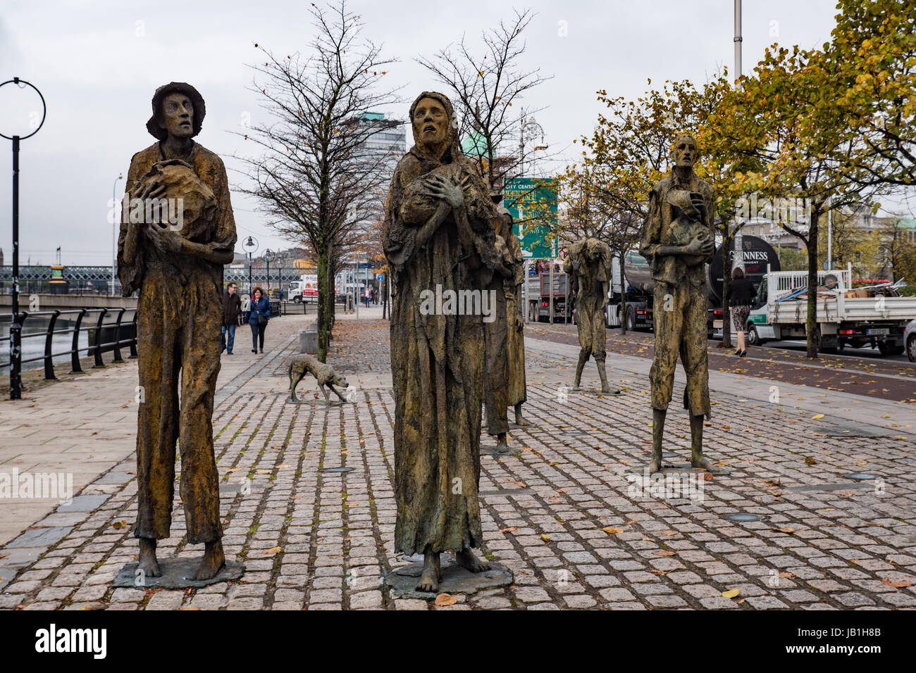 The Famine Sculptures created by Rowan Gillespie in 1997 and situated on Custom House Quay on the banks of the River - Stock Image