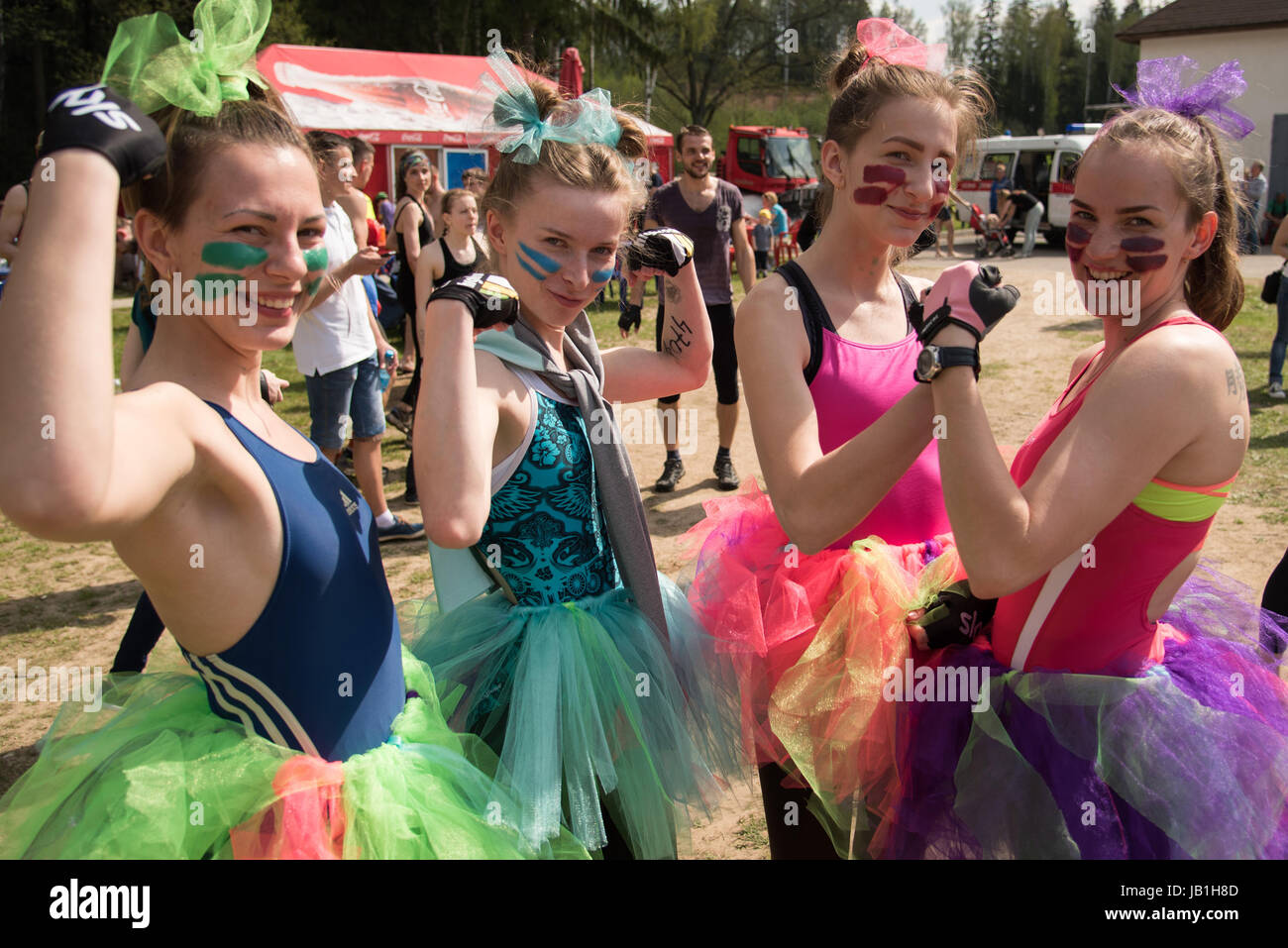 May 7, Minsk, Belarus. – Happy team of female participants of extreme run with natural and artificial obstacles - Stock Image