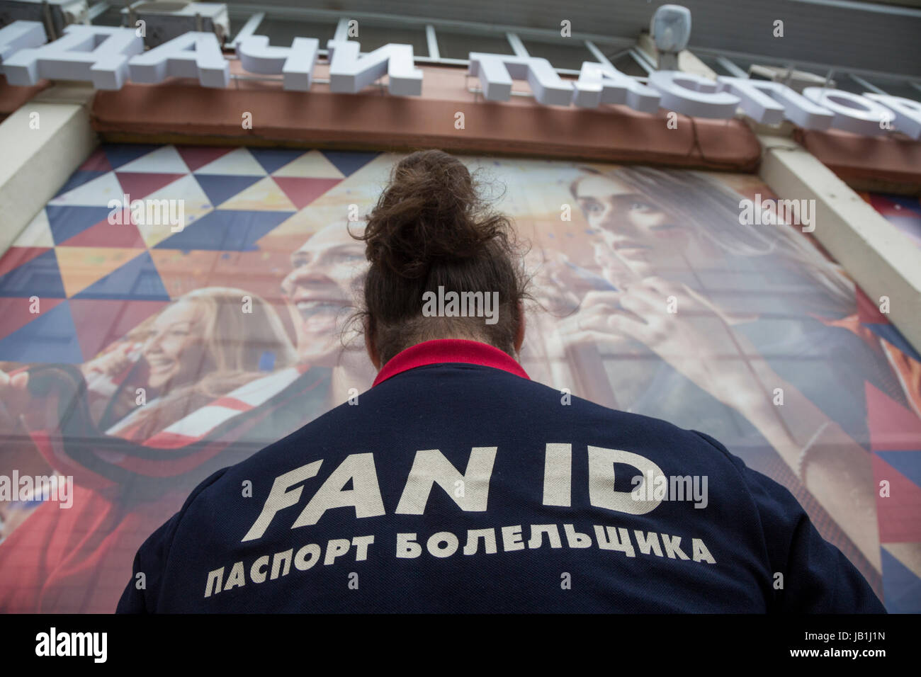 Volunteers help to fans of the World Cup at the point of issue of the Fan ID in Moscow city, Russia - Stock Image
